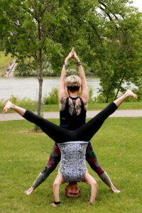 Shirley and Leanne performing 2 person yoga pose